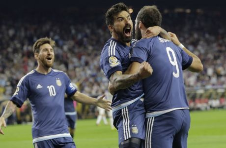Argentina forward Gonzalo Higuain (9) celebrates his goal against the United States with midfielder Lionel Messi, left, and  forward Ezequiel Lavezzi, center, during a Copa America Centenario semifinal soccer match, Tuesday, June 21, 2016, in Houston. Argentina won 4-0. (AP Photo/Eric Gay)