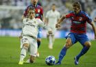 Real's Luka Modric, left, challenges for the ball with Plzen's Milan Petrzela during the Champions League, group G, soccer match between Real Madrid and Viktoria Plzen at the Santiago Bernabeu stadium in Madrid, Spain, Tuesday Oct. 23, 2018. (AP Photo/Paul White)