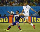 REFILE - CORRECTING IDENTITY OF JAPAN'S PLAYER   Greece's Kostas Manolas (in white) kicks the ball next to Japan's Shinji Okazaki during their 2014 World Cup Group C soccer match at the Dunas arena in Natal June 19, 2014. REUTERS/Kai Pfaffenbach (BRAZIL  - Tags: SOCCER SPORT WORLD CUP)