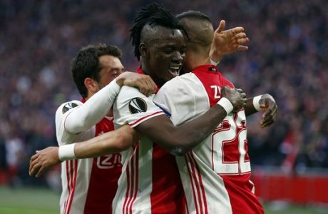 Ajax's Bertrand Traore, center, celebrates with his teammates after scoring the fourth goal of his team during the first leg semi final soccer match between Ajax and Olympique Lyon in the Amsterdam ArenA stadium, Netherlands, Wednesday, May 3, 2017. (AP Photo/Peter Dejong)