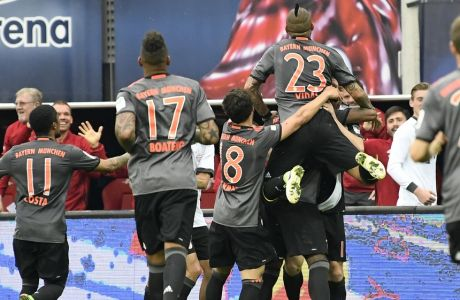 Team FC Bayern Munich celebrate after scoring a goal during the German first division Bundesliga soccer match between RB Leipzig and FC Bayern Munich in Leipzig, Germany, Saturday, May 13, 2017. Munich won by 5-4 .(AP Photo/Jens Meyer)