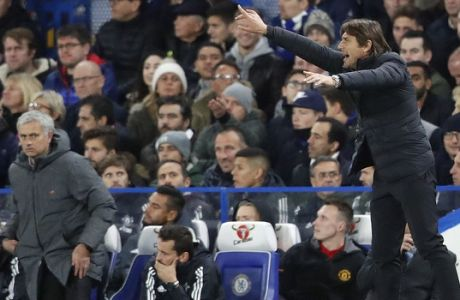 Manchester United head coach Jose Mourinho , left, and Chelsea's team manager Antonio Conte gesture during the English Premier League soccer match between Chelsea and Manchester United at Stamford Bridge stadium in London, Sunday, Nov. 5, 2017.(AP Photo/Frank Augstein)