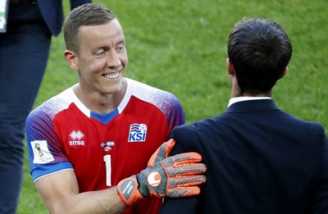 Iceland goalkeeper Hannes Halldorsson, left, is congratulated by a teammate following their group D match between Argentina and Iceland at the 2018 soccer World Cup in the Spartak Stadium in Moscow, Russia, Saturday, June 16, 2018. (AP Photo/Rebecca Blackwell)