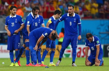 RECIFE, BRAZIL - JUNE 29: (L-R) Konstantinos Katsouranis, Giorgos Samaras, Sokratis Papastathopoulos, Theofanis Gekas, Giorgos Karagounis, Konstantinos Mitroglou and Vasilis Torosidis of Greece react after being defeated by Costa Rica in a penalty shootout during the 2014 FIFA World Cup Brazil Round of 16 match between Costa Rica and Greece at Arena Pernambuco on June 29, 2014 in Recife, Brazil.  (Photo by Quinn Rooney/Getty Images)