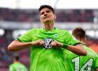 Wolfsburg's Mario Gomez celebrates his third goal during the German Bundesliga soccer match between Bayer Leverkusen and VfL Wolfsburg in Leverkusen, Germany, Sunday, April 2, 2017. The match ended 3-3, Gomez scored a hattrick. (AP Photo/Martin Meissner)