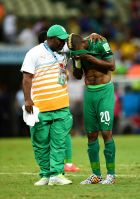 FORTALEZA, BRAZIL - JUNE 24:  A dejected Die Serey of the Ivory Coast is consoled after being defeated by Greece 2-1 during the 2014 FIFA World Cup Brazil Group C match between Greece and the Ivory Coast at Castelao on June 24, 2014 in Fortaleza, Brazil.  (Photo by Jamie McDonald/Getty Images)