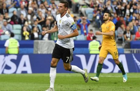 Germany's Julian Draxler celebrates after scoring his side's second goal during the Confederations Cup, Group B soccer match between Australia and Germany, at the Fisht Stadium in Sochi, Russia, Monday, June 19, 2017. (AP Photo/Martin Meissner)