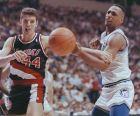 Portland Trail Blazers' Drazen Petrovic (44) keeps Minnesota Timberwolves Tony Campbell at bay with his arm as the two chased a loose ball in NBA action in Minneapolis, April 10, 1990. (AP Photo/Jim Mone)