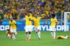 BELO HORIZONTE, BRAZIL - JUNE 28:  (L-R) Thiago Silva, Dani Alves, Jo, Hulk, Willian and Neymar of Brazil celebrate after defeating Chile in a penalty shootout during the 2014 FIFA World Cup Brazil round of 16 match between Brazil and Chile at Estadio Mineirao on June 28, 2014 in Belo Horizonte, Brazil.  (Photo by Quinn Rooney/Getty Images)