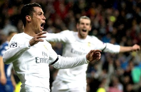 """Real Madrid's Portuguese forward Cristiano Ronaldo celebrates after scoring during the Champions League quarter-final second leg football match Real Madrid vs Wolfsburg at the Santiago Bernabeu stadium in Madrid on April 12, 2016. / AFP / CURTO DE LA TORRE        (Photo credit should read CURTO DE LA TORRE/AFP/Getty Images)"""