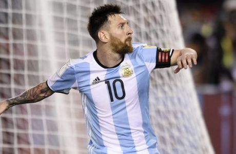 Argentinas Lionel Messi celebrates after scoring a penalty kick during a 2018 Russia World Cup qualifying soccer match between Argentina and Chile at the Monumental stadium in Buenos Aires, Argentina, Thursday March 23, 2017.(AP Photo/Gustavo Garello)
