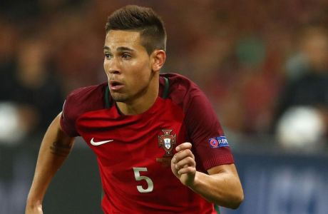 SAINT-ETIENNE, FRANCE - JUNE 14:  Raphael Guerreiro of Portugal during the UEFA EURO 2016 Group F match between Portugal and Iceland at Stade Geoffroy-Guichard on June 14, 2016 in Saint-Etienne, France.  (Photo by Michael Steele/Getty Images)