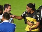 BELO HORIZONTE, BRAZIL - JUNE 11:  A fan bearing the resemblance of Ronaldinho is escorted off the field while talking to Lionel Messi of Argentina after an open trainging session ahead of the 2014 FIFA World Cup on June 11, 2014 in Belo Horizonte, Brazil.  (Photo by Ronald Martinez/Getty Images)