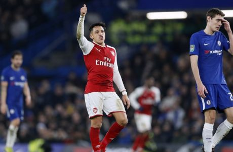 Arsenal's Alexis Sanchez gestures during the English League Cup semifinal, first leg, soccer match between Chelsea and Arsenal at Stamford Bridge stadium in London, Wednesday, Jan. 10, 2018. (AP Photo/Kirsty Wigglesworth)