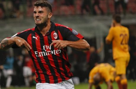 AC Milan's Patrick Cutrone celebrates after scoring his side's 2nd goal during the Serie A soccer match between AC Milan and Roma at the Milan San Siro Stadium, Italy, Friday, Aug. 31, 2018. (AP Photo/Antonio Calanni)