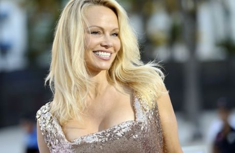 """Pamela Anderson arrives at the U.S. Premiere of """"Baywatch"""" at Lummus Park on Saturday, May 13, 2017, in Miami Beach, Fla. (Photo by Omar Vega/Invision/AP)"""