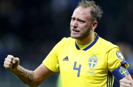 Sweden's Andreas Granqvist celebrates at the end of the World Cup qualifying play-off second leg soccer match between Italy and Sweden, at the Milan San Siro stadium, Italy, Monday, Nov. 13, 2017. Four-time champion Italy has failed to qualify for World Cup; Sweden advances with 1-0 aggregate win in playoff. (AP Photo/Antonio Calanni)