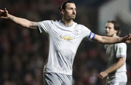 Manchester United's Zlatan Ibrahimovic celebrates scoring his side's first goal of the game during the English League Cup Quarter Final soccer match between Bristol City and Manchester United at Ashton Gate, Bristol, England, Wednesday, Dec. 20, 2017. (Nick Potts/PA via AP)
