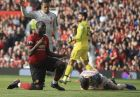 Manchester United's Romelu Lukaku, left, reacts after missing a scoring chance during the English Premier League soccer match between Manchester United and Liverpool at Old Trafford stadium in Manchester, England, Sunday, Feb. 24, 2019. (AP Photo/Jon Super)