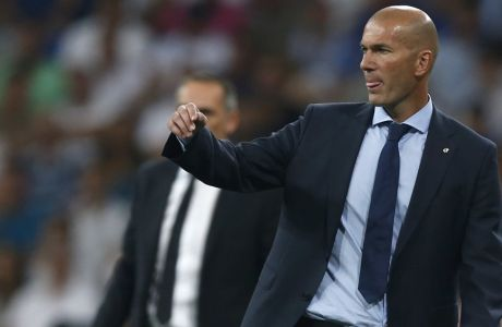 Real Madrid coach Zinedine Zidane reacts during a Champions League group H soccer match between Real Madrid and Apoel Nicosia at the Santiago Bernabeu stadium in Madrid, Spain, Wednesday, Sept. 13, 2017. (AP Photo/Francisco Seco)