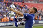 Chelsea's Eden Hazard celebrates with the trophy after winning the English FA Cup final soccer match between Chelsea and Manchester United at Wembley stadium in London, Saturday, May 19, 2018. Chelsea defeated Manchester United 1-0. (AP Photo/Tim Ireland)