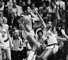 North Carolina A & T center Juan Lanauze, left, goes up looking to pass over Princeton University forward Craig Robinson during the first half of NCAA preliminary basketball playoff action at the Palestra in Philadelphia on Tuesday, March 15, 1983. (AP Photo/Peter Morgan)