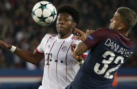 Bayern's David Alaba, left, and PSG's Dani Alves challenge for the ball during the Champions League Group B soccer match between Paris Saint-Germain and Bayern Munich in Paris, France, Wednesday, Sept. 27, 2017. (AP Photo/Thibault Camus)