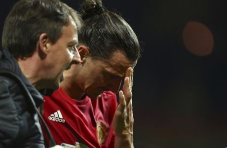 Manchester United's Zlatan Ibrahimovic leaves the field with an injury during the Europa League quarterfinal second leg soccer match between Manchester United and Anderlecht at Old Trafford stadium, in Manchester, England, Thursday, April 20, 2017. (AP Photo/Dave Thompson)