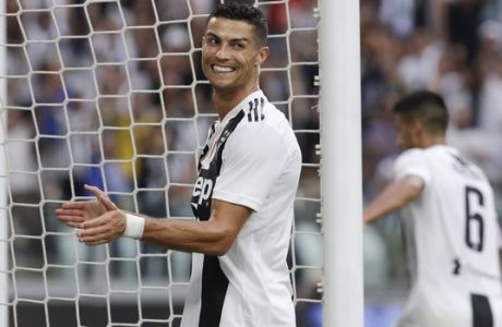 Juventus' Cristiano Ronaldo celebrates after his teammate Mario Mandzukic scored during a Serie A soccer match between Juventus and Lazio, at the Allianz stadium in Turin, Italy,Saturday, Aug. 25, 2018. (AP Photo/Luca Bruno)