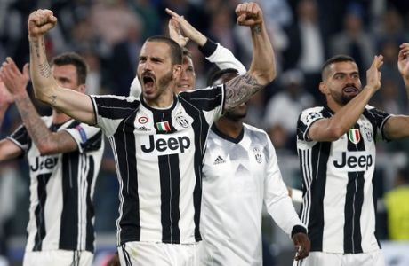 Juventus' Leonardo Bonucci, front, celebrates after the Champions League semi final second leg soccer match between Juventus and Monaco in Turin, Italy, Tuesday, May 9, 2017. Juventus defeated Monaco by 2-1. (AP Photo/Antonio Calanni)