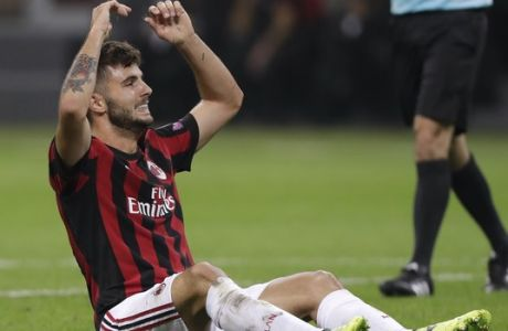 AC Milan's Patrick Cutrone reacts after missing a scoring chance during the Europa League group D soccer match between AC Milan and Rijeka, at the Milan San Siro Stadium, Italy, Thursday, Sept. 28, 2017. (AP Photo/Luca Bruno)