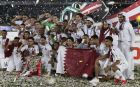 Players and team members of Qatar celebrate with trophy after winning the AFC Asian Cup final match between Japan and Qatar in Zayed Sport City in Abu Dhabi, United Arab Emirates, Friday, Feb. 1, 2019. (AP Photo/Hassan Ammar)