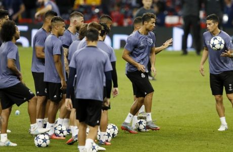 Real Madrid's James Rodriguez, right, holds the ball during a training session at the Millennium Stadium in Cardiff, Wales Friday June 2, 2017. Real Madrid will play Juventus in the final of the Champions League soccer match in Cardiff on Saturday. (AP Photo/Kirsty Wigglesworth)