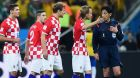 SAO PAULO, BRAZIL - JUNE 12: Referee Yuichi Nishimura is pursued by Dejan Lovren, Sime Vrsaljko, Nikica Jelavic and Ivan Rakitic of Croatia after awarding a penalty kick during the 2014 FIFA World Cup Brazil Group A match between Brazil and Croatia at Arena de Sao Paulo on June 12, 2014 in Sao Paulo, Brazil.  (Photo by Christopher Lee/Getty Images)