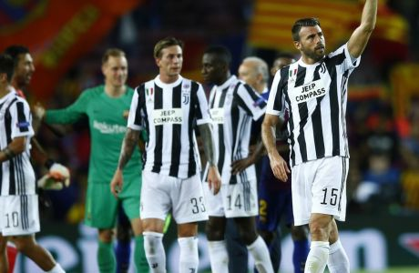 Juventus players react to their supporters at the end of a group D Champions League soccer match between FC Barcelona and Juventus at the Camp Nou stadium in Barcelona, Spain, Tuesday, Sept. 12, 2017. (AP Photo/Manu Fernandez)