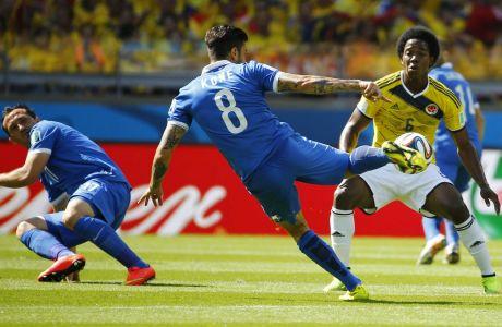 Ο Παναγιώτης Κονέ σε προσπάθεια του στην αναμέτρηση Ελλάδα-Κολομβία στο Παγκόσμιο Κύπελλο της Βραζιλίας το 2014. | 14/06/2014