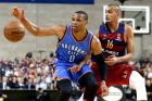 Oklahoma City Thunder guard Russell Westbrook, left, reaches for a loose ball during a NBA Global Games basketball match between Barcelona and Oklahoma City Thunder at the Palau Sant Jordi, Barcelona, Spain Wednesday Oct. 5, 2016. (AP Photo/Manu Fernandez)