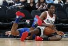 Portland Trail Blazers forward Al-Farouq Aminu, front, recovers a loose ball as Denver Nuggets guard Gary Harris tumbles next to him during the second half of an NBA basketball game Friday, April 5, 2019, in Denver. The Nuggets won 119-110. (AP Photo/David Zalubowski)