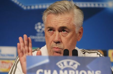 Bayern Munich's coach Carlo Ancelotti gestures as he speaks during a media conference at Parc des Prince stadium ahead of the Champions League soccer match between Bayern Munich and Paris Saint Germain in Paris, Tuesday, Sept. 26, 2017. Bayern Munich will face Paris Saint Germain (AP Photo/Michel Euler)