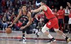 Portland Trail Blazers guard CJ McCollum, left, dribbles around Houston Rockets guard Austin Rivers during the second half of an NBA basketball game in Portland, Ore., Saturday, Jan. 5, 2019. The Blazers won 110-101. (AP Photo/Craig Mitchelldyer)