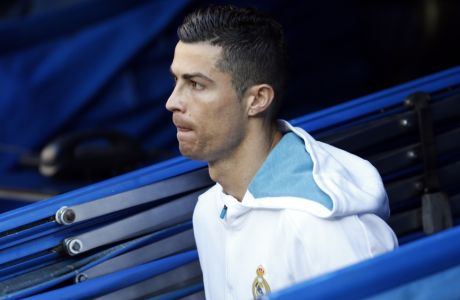 Real Madrid's Cristiano Ronaldo enters the field for the Spanish La Liga soccer match between Real Madrid and Barcelona at the Santiago Bernabeu stadium in Madrid, Spain, Saturday, Dec. 23, 2017. (AP Photo/Francisco Seco)