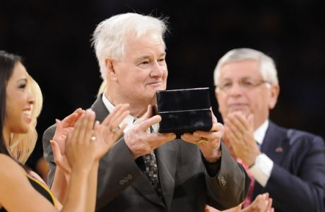 """Lakers assistant coach Fred """"Tex"""" Winter, 87, receives his championship ring in the middle of the second half of a NBA basketball game against the Los Angeles Clippers, Tuesday, Oct. 27, 2009, in Los Angeles. The Lakers won 99-92.  (AP Photo/Gus Ruelas)"""