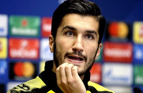 Dortmund's Nuri Sahin attends a press conference before a training session at Wembley stadium in London, Tuesday, Sept. 12, 2017. Dortmund play Tottenham Hotspur in a Champions League Group H soccer match at Wembley on Wednesday. (AP Photo/Matt Dunham)