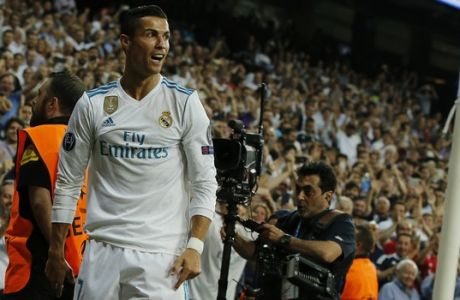 Real Madrid's Cristiano Ronaldo reacts after scoring the first goal during a Champions League group H soccer match between Real Madrid and Apoel Nicosia at the Santiago Bernabeu stadium in Madrid, Spain, Wednesday, Sept. 13, 2017. (AP Photo/Paul White)