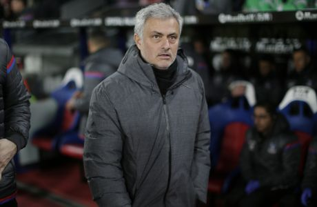 Manchester United manager Jose Mourinho looks across the pitch before the English Premier League soccer match between Crystal Palace and Manchester United at Selhurst Park in London, Monday, March 5, 2018. (AP Photo/Tim Ireland)