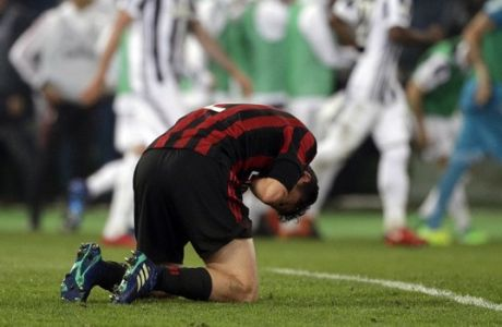 AC Milan's Davide Calabria lies on the pitch as Juventus players celebrate in background after Juventus' Medhi Benatia scored, during the Italian Cup final soccer match between Juventus and AC Milan, at the Rome Olympic stadium, Wednesday, May 9, 2018. (AP Photo/Gregorio Borgia)