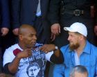 Former world heavyweight boxing champion Mike Tyson, left, speaks with Deputy Prime Minister Ramzan Kadyrov during a sports show in Gudermes, Chechnya, Thursday, Sept. 15, 2005.  Tyson on Thursday opened a boxing tournament in Chechnya, becoming the first international celebrity to visit the war-ravaged Russian republic.  (AP Photo/Artur Magomadov)