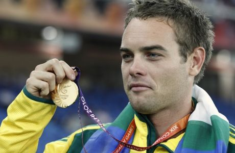 Australia's Jarrod Bannister poses with his gold medal for the Men's Javelin during the Commonwealth Games at the Jawaharlal Nehru Stadium in New Delhi, India, Tuesday, Oct. 12, 2010. (AP Photo/Anja Niedringhaus)