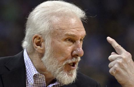 San Antonio Spurs head coach Gregg Popovich calls to players during the second half of Game 6 in an NBA basketball first-round playoff series against the Memphis Grizzlies Thursday, April 27, 2017, in Memphis, Tenn. (AP Photo/Brandon Dill)