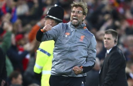 Liverpool coach Jurgen Klopp celebrates after Liverpool's Mohamed Salah scored the opening goal during the Champions League semifinal, first leg, soccer match between Liverpool and AS Roma at Anfield Stadium, Liverpool, England, Tuesday, April 24, 2018. (AP Photo/Dave Thompson)